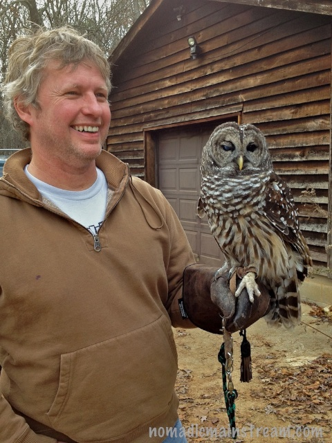 Pat holding Artie, a physically challenged Barred Owl that cannot survive in the wild.