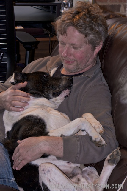 Pat cuddling Tisen shortly after he came to live with us.
