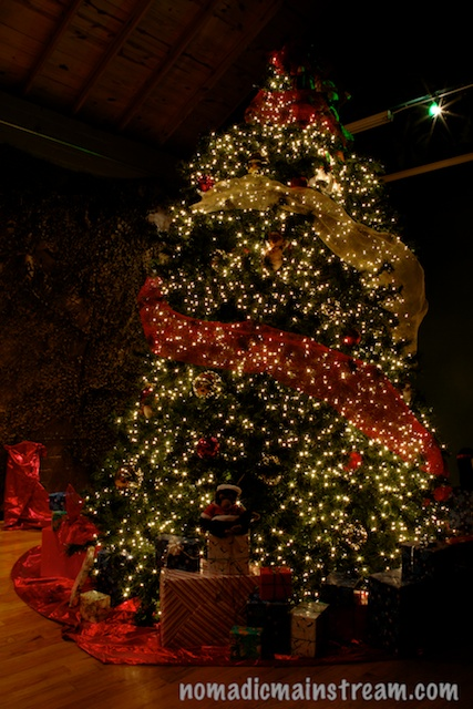 This very real looking artificial tree is easily 20 feet tall.