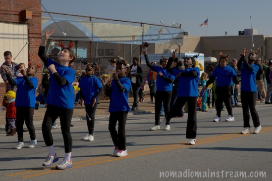 A middle school group of girls tosses their batons