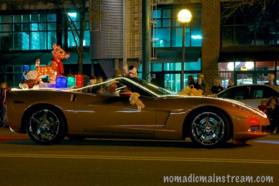 A brightly lit Rudolf adorns this collectible car.