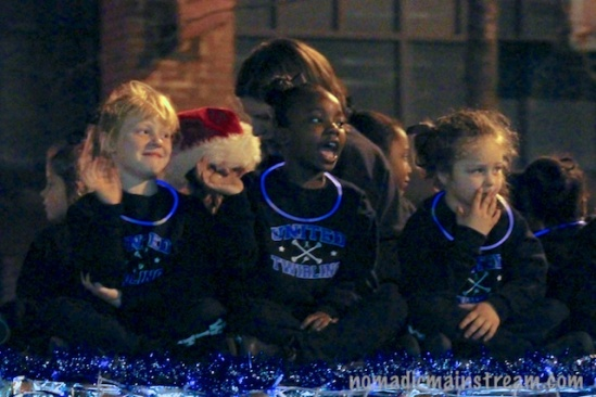 Grainy close up of some of the girls on the tiny tots twirlers float I mentioned yesterday.
