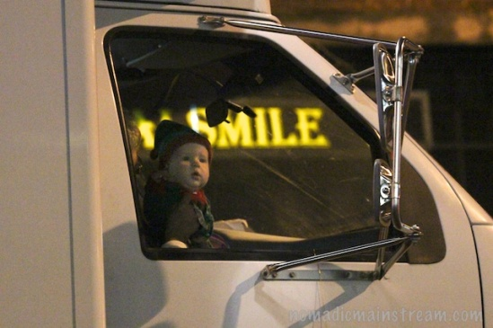 The lighted sign appeared like a thought bubble above this curious baby's head.