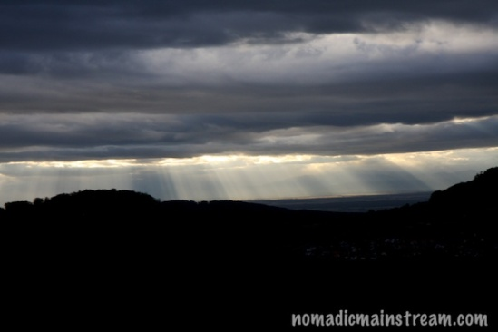 "I love light beams peeping through clouds--""god beams"" as at least one of my photographer friends calls them."