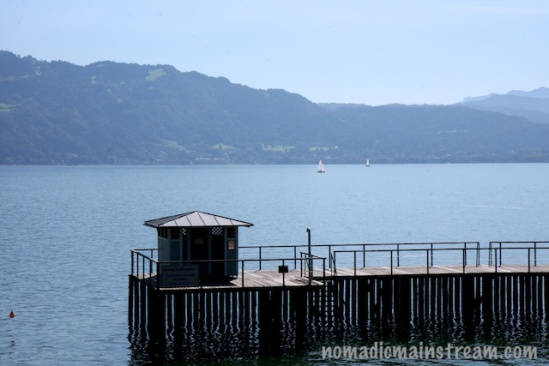 Beautiful sailboats sail peacefully on this calm day on the Bodensee in Germany.