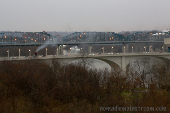 Smoke billows in the wind over the bridge