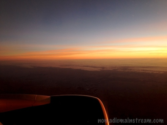 Sunrise from plane window as we approach Madrid (iPhone)