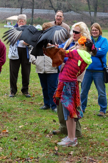The young lady celebrated her birthday holding a vulture