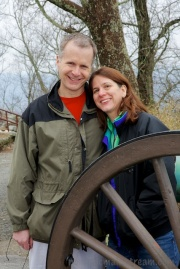 My brother and sister-in-law posing being the wheel of a canon at Point Park