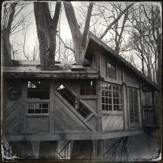 Up close look at the crazy angles of the treehouse--love the diagonal window