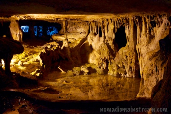 A highly reflective pool below cave formations