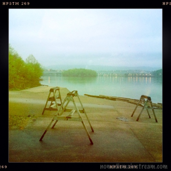 Looking across the rests used for sculling boats to McClellan Island