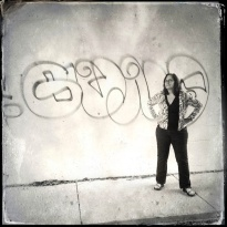 Gina looking fierce in front of unwanted graffiti