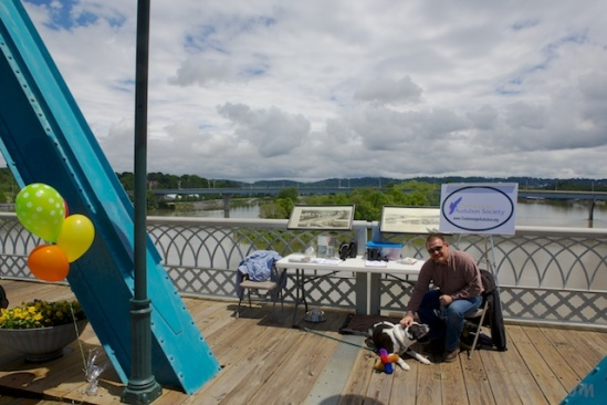 Tisen kept my fellow volunteer busy while I got a shot of the booth, McClellan Island in the background, and some rapidly forming clouds overhead
