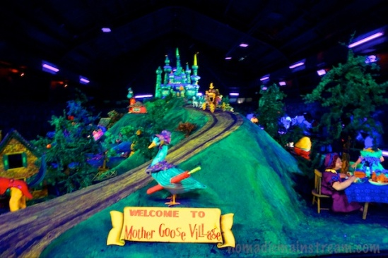 Mother Goose Village rises up out of the dark