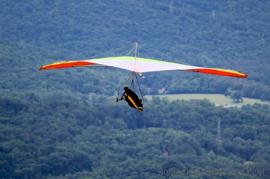 I switched cameras to catch the hang glider as it pulled away from the mountain.