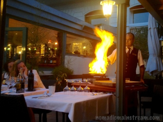 Dramatic dinner preparation at a nearby table