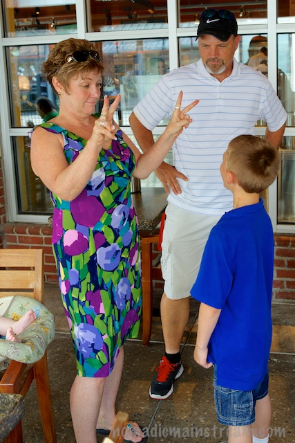 Grandma demonstrating how to make a finger jump from one hand to the other