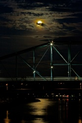 Full moon over bridge and water