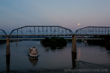 Moon over bridge at sunset
