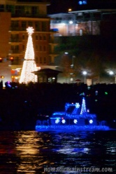My personal favorite boat in front of the Ross's Landing Christmas Tree