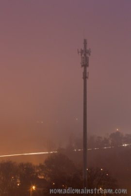 Cell tower, fog, and highway traffic